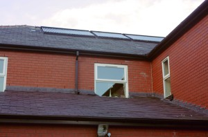 solar collectors on the roof utilising the sun's power to heat our hot water